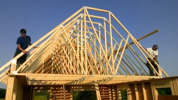 We space the trusses every 2 feet, same as the studs.