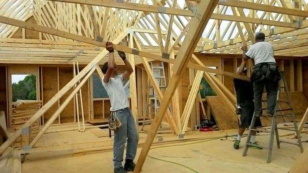 Raising the last roof truss is like threading a 120-pound needle.
