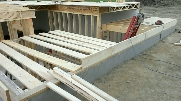 Complex stud walls around the stairwell, before installing the floor joists and plywood.