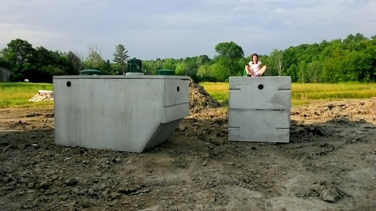 The septic tanks before they got buried. (Kiara for scale.)