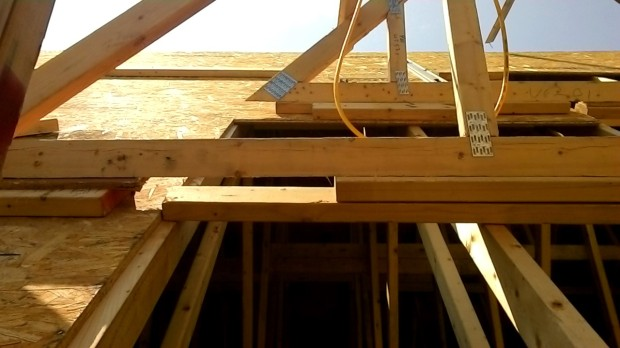 Looking up at the triangle trusses in progress. Note the shims underneath.