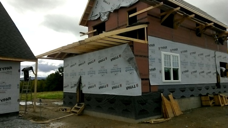 Rafters for the shed roof over the porch and mudroom... wow, what a difference!
