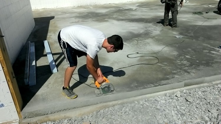 Cutting concrete - saw fitted with a masonry blade.