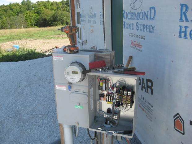 The transfer switch at one end of the conduit.