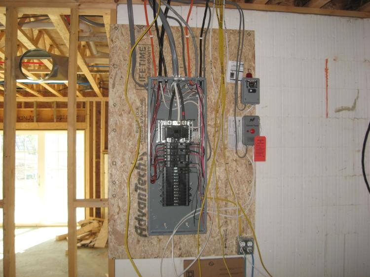 The electrical panel grows in complexity.