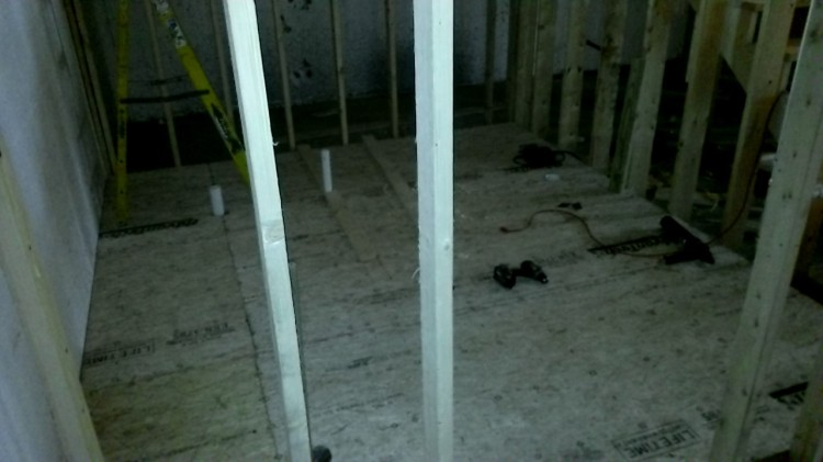 Basement interior update: subfloor in the bathroom. (Check out all the pipes poking through.)