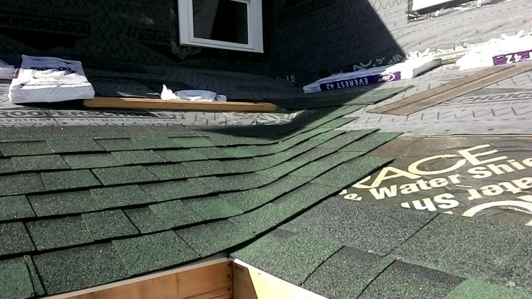 Shingles in progress - overlapping at the valley.