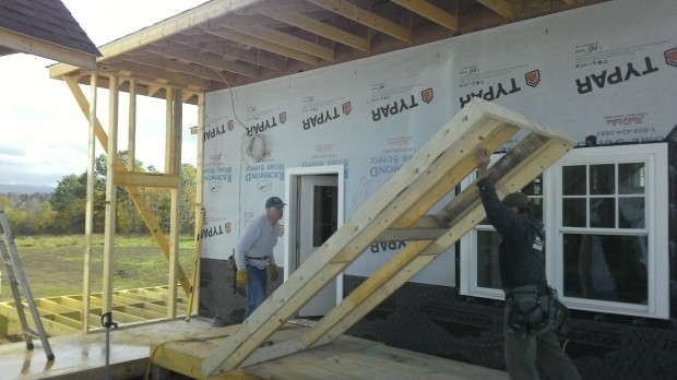 Colin and Terry raise the breezeway walls.