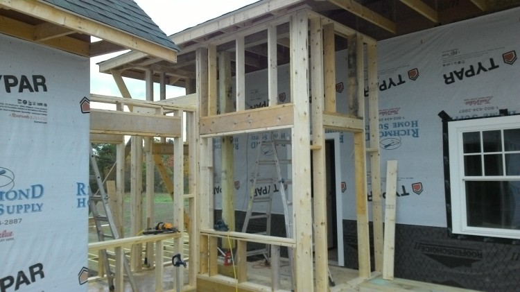 We had to jack up the shed roof to squeeze in the second top plate for the breezeway walls.