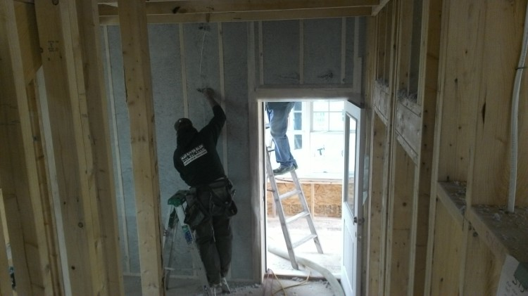 Terry runs cable out the breezeway... WAY harder now that the walls are stuffed with insulation.