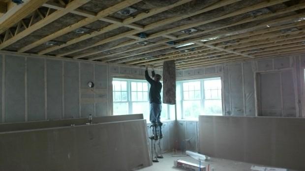 The kitchen-ceiling insulator wore stilts!
