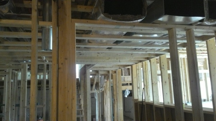 Drop ceiling over the basement hallway.