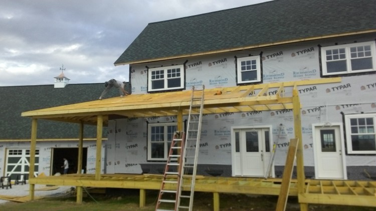 Roofing the hip.