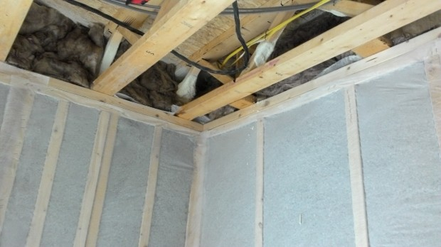 Insulation batts fill the space between floors.