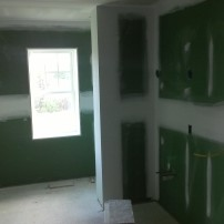 The master bathroom gets mold-resistant Green Board.