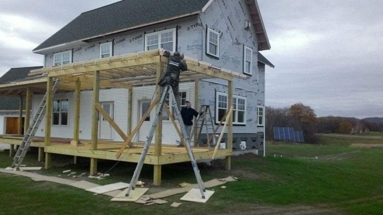 Adding lumber to make every truss the right height.