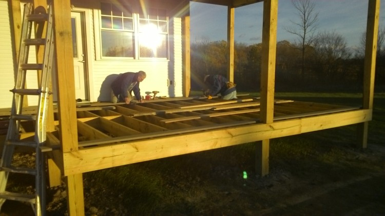 Starting to deck the front porch. At 56 feet long, each row requires three planks end to end.