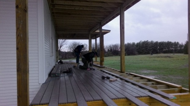 Major progress on the front porch decking. Weather is hideous.