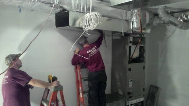 Joe installs a maze of ducts in the mechanical room.