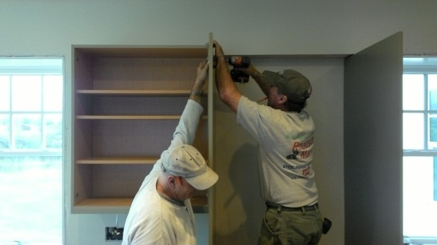 Thru-bolting a wall cabinet to a trim piece.