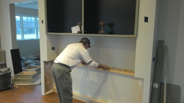 Back to rough framing: Terry installs lumber to space out the hutch cabinetry.