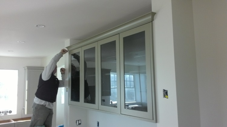 Terry completes crown molding on the hutch.