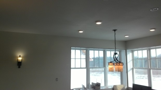 One wall sconce, four flush-mounts, and a chandelier.