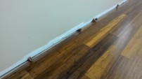 Spacers at edge of room.
