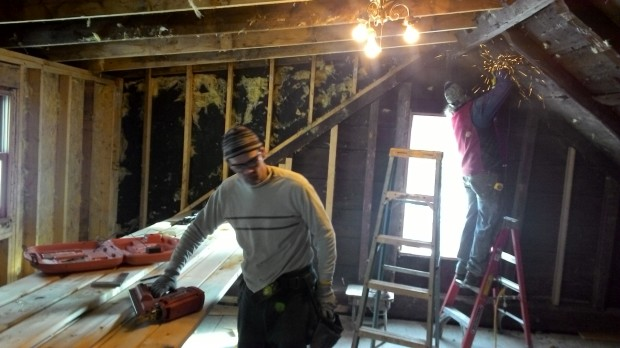 Bob grinds out nails, Hans cuts rafters.