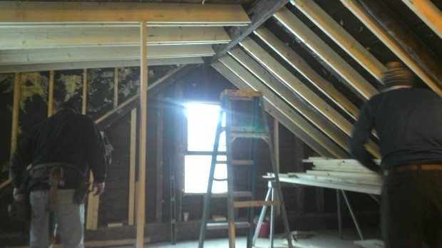 Mark and Hans work on dormer rafters.