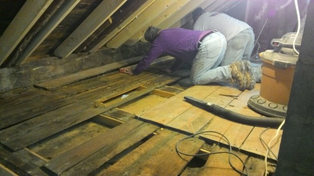 Mark and Bob pulling up floorboards.