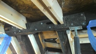 "Bob's ""work of art"" homemade joist hanger."