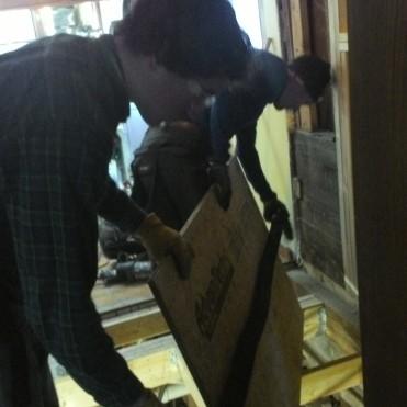 Hans and I lay plywood.
