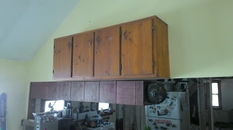 We removed this cabinet from Bob's doomed kitchen wall and hung it in the dining room.