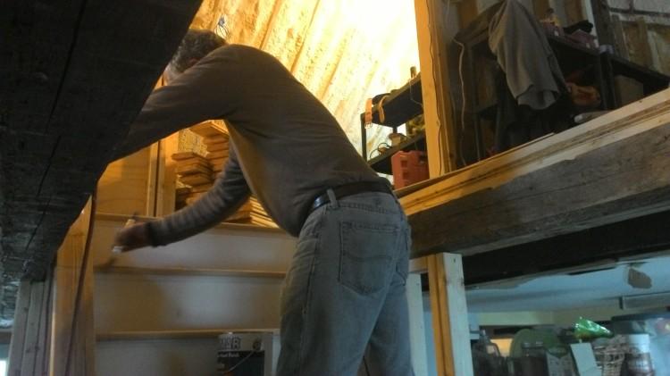Mark brushes polyurethane onto the new steps.