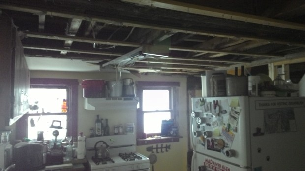 The newly ceilingless kitchen.