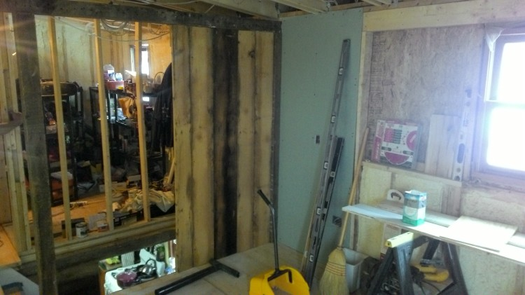 First (fixed) door installed. Note the header and posts, and new drywall just to the right.