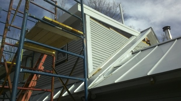 KLEER installed - the white woodlike material around the upper eave.