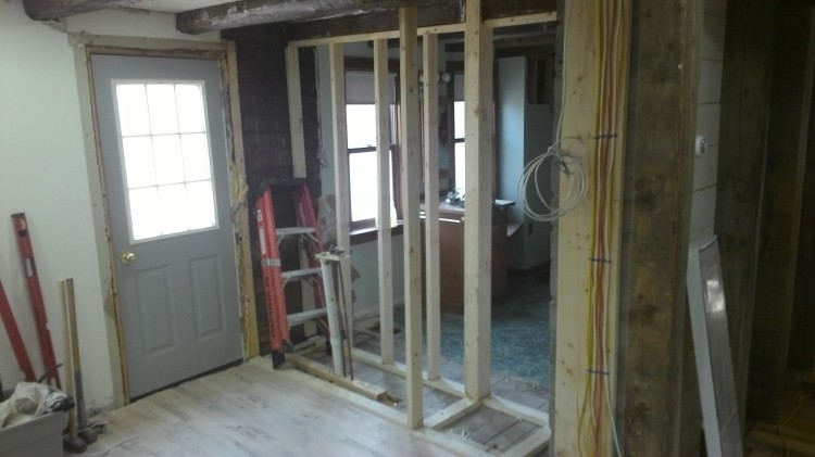 Bathroom/living room wall framed. The class subsequently installed drywall.
