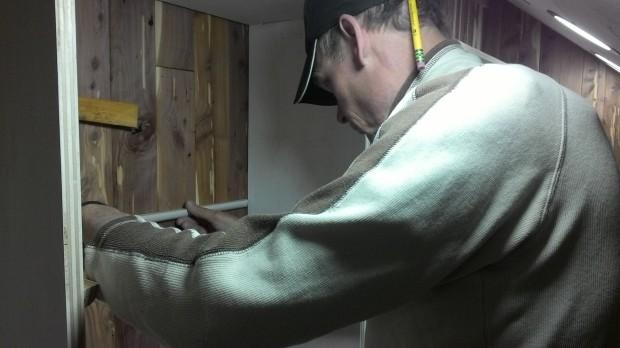 Hans installs a quarter-round shelf support.