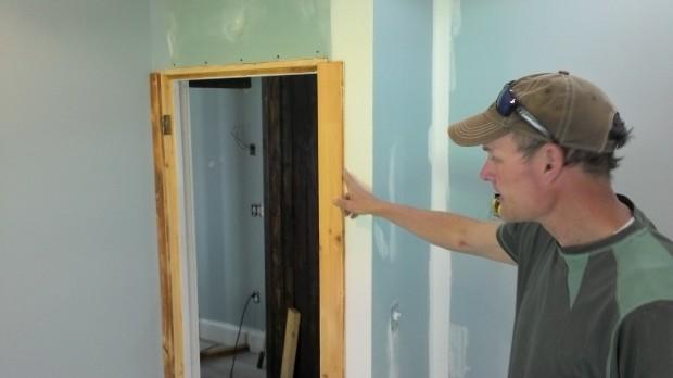 Hans faces the guest room doorway.