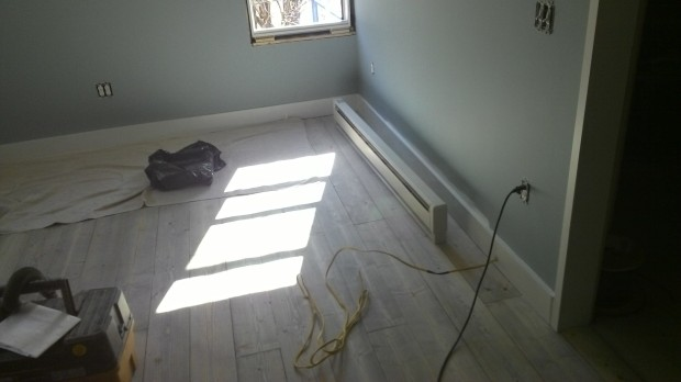 Master bedroom floor, surrounded by baseboard and ready for the baseboard heater hookup.