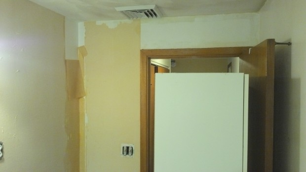 Once the facing is gone, the wet backing peels off easily, one panel at a time.