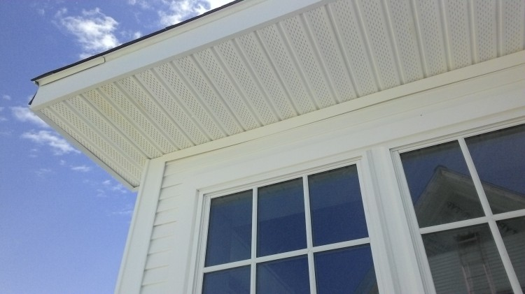 A finished soffit, surrounded by channels and aluminum trim.