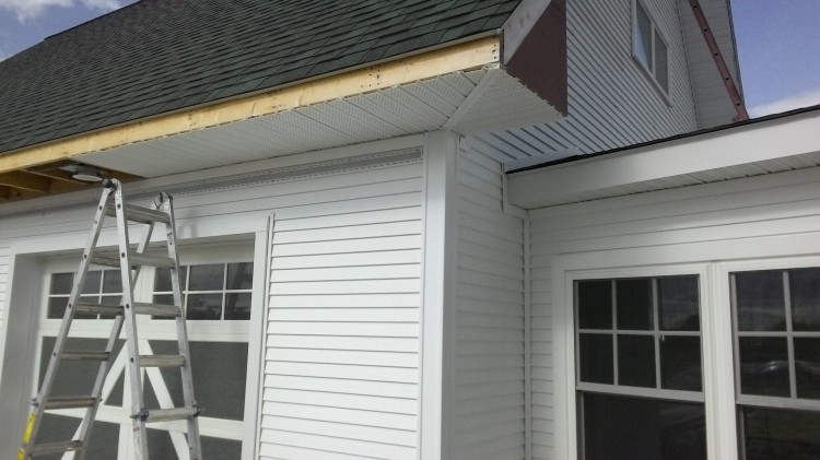 Soffit return in the southwest corner of the Barn: two narrow J-channels back-to-back.