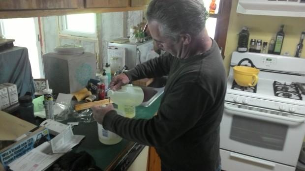Mark carefully mixes epoxy.