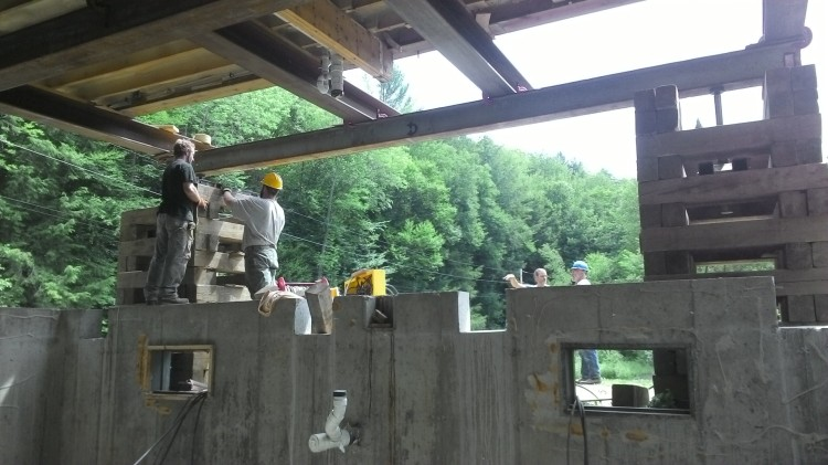 Notches in the foundation wall - see how the steel beams fit before lifting the house.