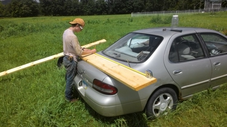 It's not a junk car, it's a combination shed/sawhorse! Luke lays out a ridge beam.