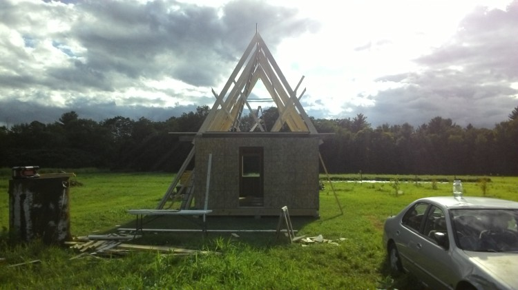 End of day. A cathedral roof frame rules over Liam and Jenny's empire.