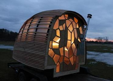 This tiny house, built by Green Mountain College students, is a piece of art. (from the Boston Globe article)